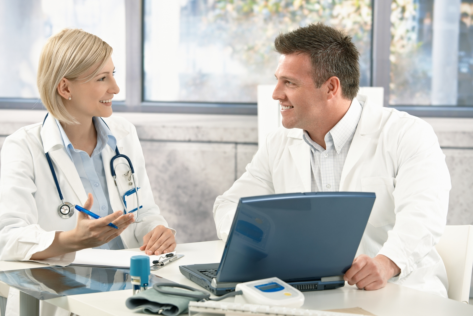 bigstock-Two-medical-doctors-consulting-18161861